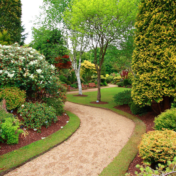 Winding path lined with manicured trees and shrubs, LawnWise for lawn care services nashville tn, lawn care services murfreesboro tn, lawn care services smyrna tn, lawn care services la vergne tn, lawn care services franklin tn, lawn care services brentwood tn, lawn care services spring hill tn, pest control, mosquito control and turf management.